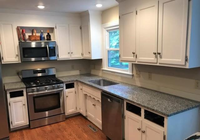 Richmond, VA - Just installed our Azul Platino on our customers own freshly painted white cabinets. This kitchen has gone through quite the transformation. It looks great!