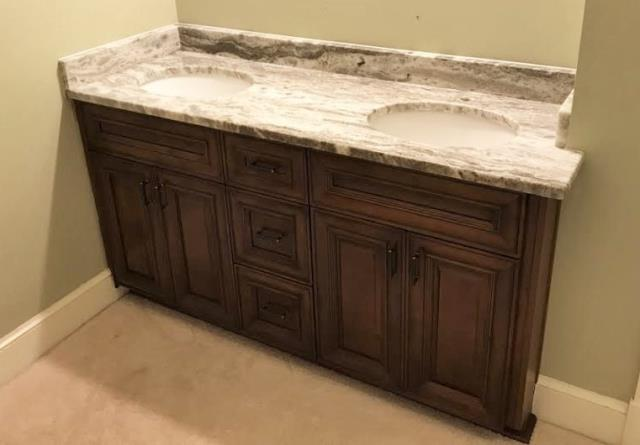 Richmond, VA - Our coffee maple cabinet with Fantasy Brown granite looks like a custom piece in our customers master bedroom vanity nook.