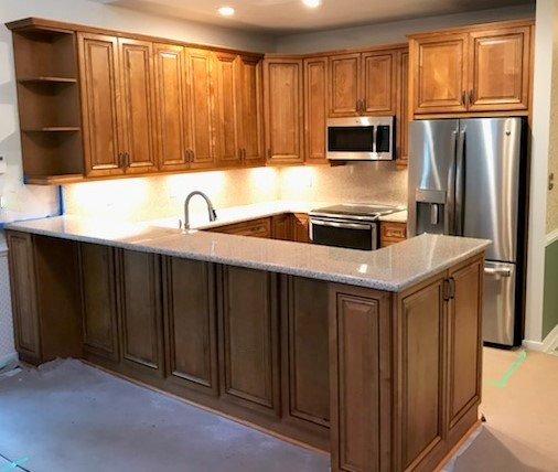 Mechanicsville, VA - We absolutely loved seeing the transformation of this kitchen! Our beaded rope maple cabinet and wheatfield granite are the perfect pair!