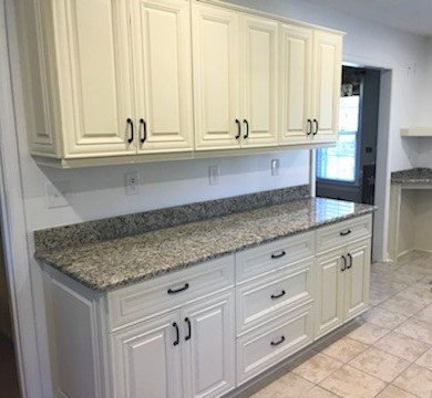 Ashland, VA - We love the look of our in-stock vanilla maple cabinets and Venetian Ice granite with the our special order gun powder finished hardware!