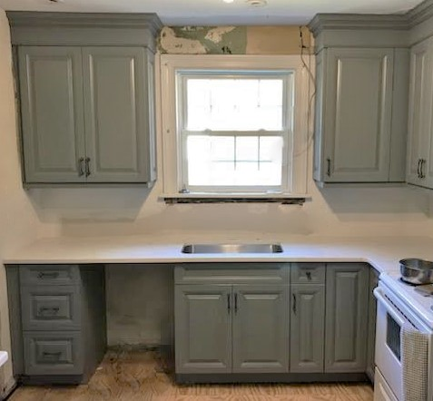 Richmond, VA - Just finished installing our brand new Gray raised panel cabinets with our classical white quartz!