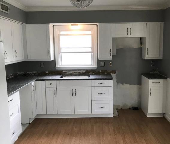 Henrico, VA - Our installers completed this white shaker kitchen with Azul Platino granite all in one day.  I can't wait for the tile back splash to be installed.