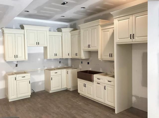 Manakin-Sabot, VA - Over the years, we have been installing kitchens and baths for my loyal contractor.  Today we our company just finished installing this gorgeous basement kitchen for one of his client.  The vanilla white maple cabinets are a perfect choice to lighten this basement.