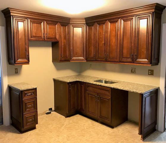 Richmond, VA - Our rich Coffee maple cabinets and Venetian Ice granite give this smaller kitchen a regal and sophisticated look. I'm so glad I was able to help a family friend with her space which has turned into a beautiful and highly functional kitchen.