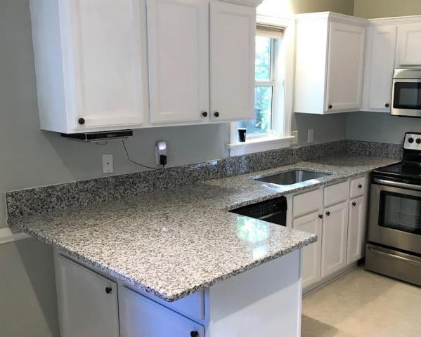 Henrico, VA - Just finished installing our Rose White granite on our clients existing cabinets. This neutral granite really brightens up this kitchen.