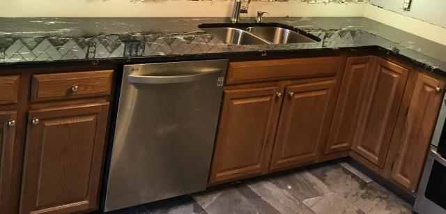 Richmond, VA - My client loves her new granite counter top we installed last Saturday.  The Paradisio Silver transformed her kitchen beautifully.