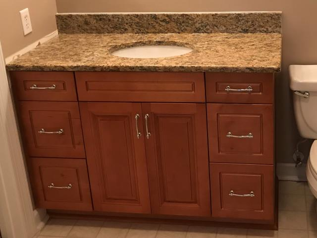Glen Allen, VA - We completed three vanities for my sweet client today.  Honey maple vanity cabinets with our popular in stock St. Cecilia.