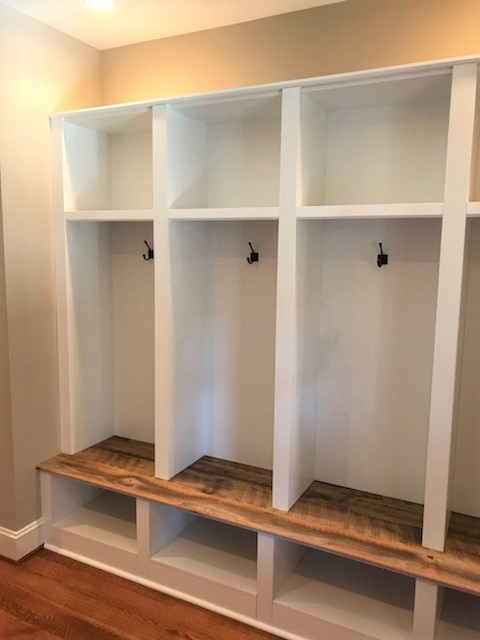 Glen Allen, VA - Our installers just finished this custom mudroom build using our white shaker paneling. It looks classic and clean with the customers own beautiful reclaimed wood seat and hooks.