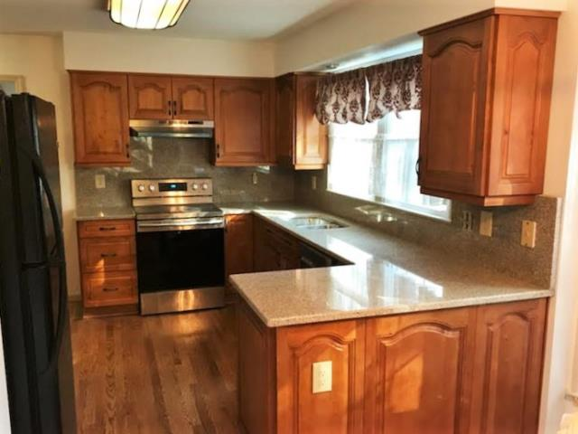 Richmond, VA - Our honey maple cabinets and Wheatfield granite are the perfect pair. We're so glad we were able to help this family put their kitchen back together after a water leak.