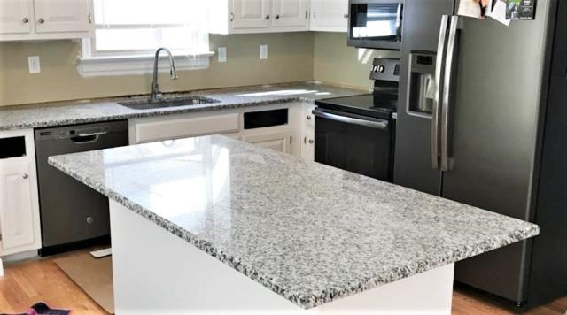 Sandston, VA - Our new Rose white granite is a muted version which adds a nice touch to white and gray kitchens without being too busy.