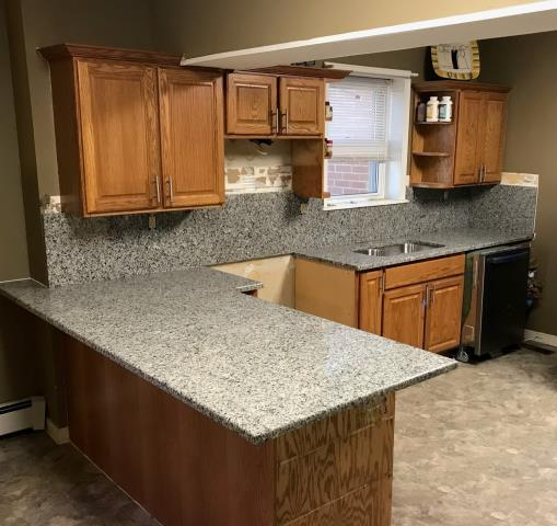 Richmond, VA - Our Azul Platino granite and full backsplash are just the beginning for this kitchen transformation. The full splash offers a clean and modern surface instead of tile.
