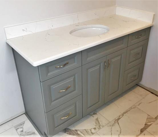 Chesterfield, VA - Wow! Our Hampton Gray raised panel vanity with our in-stock Classical White Quartz is stunning on our clients new marble floor.