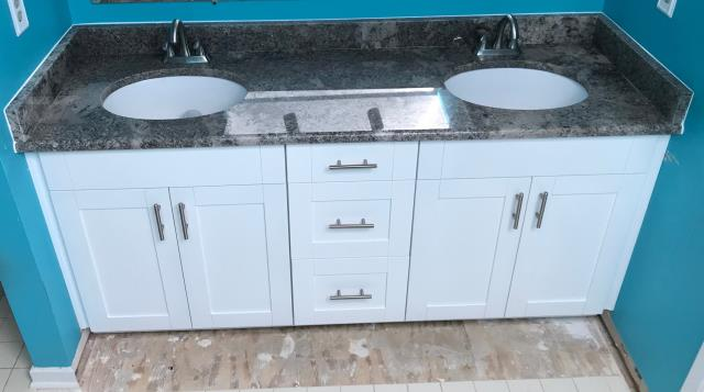 Henrico, VA - Our installers completed this double bowl vanity with thew hite shaker cabinets and the Ganache granite.  These materials are in stock at a great price.