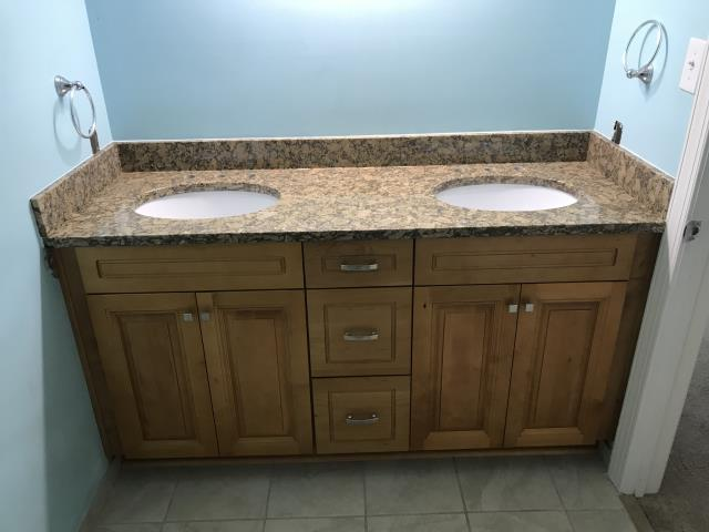 Henrico, VA - We hope our client enjoys the two new vanities our installers completed today.  Solid maple wood cabinets with granite tops.