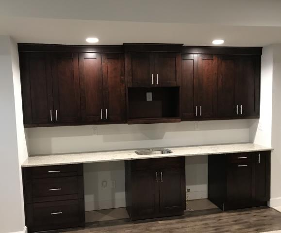 Glen Allen, VA - Our installers completed this basement kitchen in one day.  The Espresso Single Shaker goes perfectly with the Colonial White granite counter top.