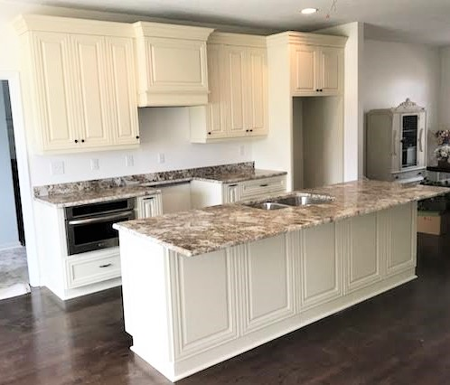 Quinton, VA - Our new Desert Beach granite is the perfect match to our Vanilla Cream cabinets and our clients rich dark wood floors. Stunning!