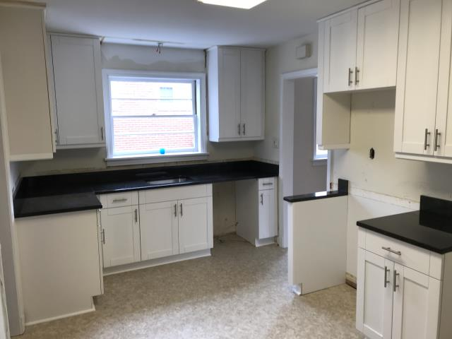 Henrico, VA - My client purchased the classic white shaker maple kitchen cabinets with the Black Pearl granite for this rental unit.  Her tenants are in for a treat.