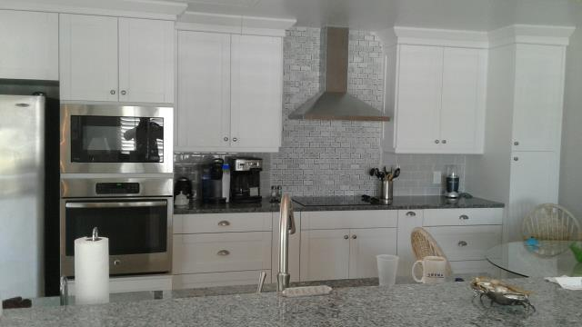 Colonial Beach, VA - I absolutely love the Azul Platino granite with our in stock white shaker maple cabinets.  My client's tile selection is a perfect match for this kichen.