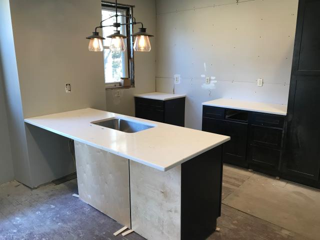 Richmond, VA - Classical White Quartz will look great with these rich dark shaker cabinets.   Can't wait to see this kitchen finished.