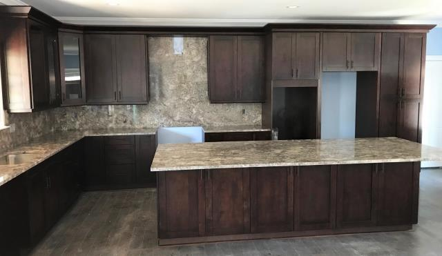 Richmond, VA - The grand kitchen with our in stock chocolate single shaker and the Ganache granite counter and full splash is stunning.  This is only one of many kitchens that we have completed for my client.  We look forward to many more kitchens.