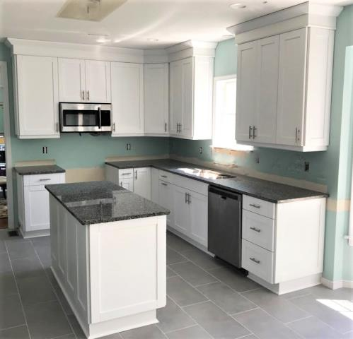 Glen Allen, VA - White Shaker maple cabinets with the Azul Platino granite counters.  Once the backsplash is installed and the walls are painted, this gorgeous kitchen will be fully completed.