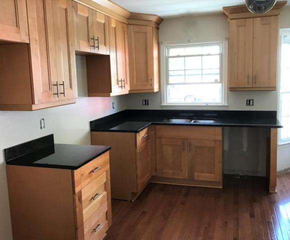 Glen Allen, VA - Our talented hard working installers completed this natural maple shaker and Uba Tuba granite counter all in one afternoon.  We are so proud to have such an amazing installation crew.