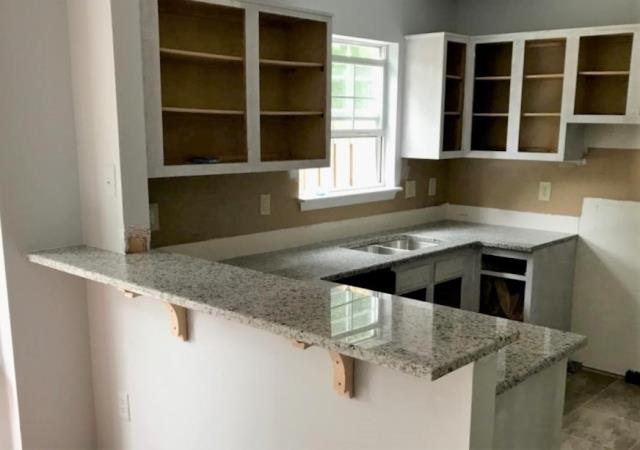 Richmond, VA - Just finished installing our In-stock Rose White granite on our clients existing cabinets that are being refinished. We can't wait to see the kitchen once it's totally renovated!