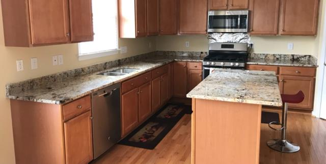 Glen Allen, VA - Our In-stock Golden Crema is the perfect match to our clients existing warm cabinets! It brings in just enough cool grays to compliment their stainless steel appliances.