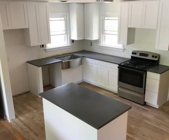 Richmond, VA - We love our in-stock white shaker cabinets & concrete gray quartz especially when paired with our customers own stainless steel farmhouse sink!