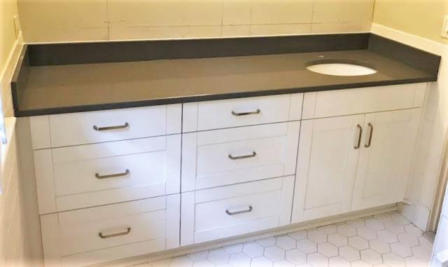 Richmond, VA - We just finished installing this clean white shaker and concrete gray quartz vanity with tons of storage and counter space for a sweet return client!