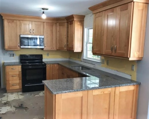 Chester, VA - Just finished installing our popular natural maple double shaker cabinets and timeless New Caledonia granite. We can't wait to see this kitchen once the new floors and backsplash have been installed!