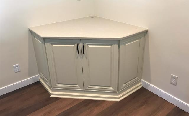Glen Allen, VA - This past weekend we installed this beautiful custom corner entertainment cabinet using our vanilla maple cabinets and in-stock Solare Brown Quartz. Simple, clean and elegant!