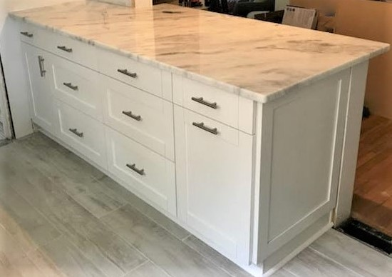 Richmond, VA - We absolutely love our Shadow Storm granite with our in-stock white shaker cabinet!