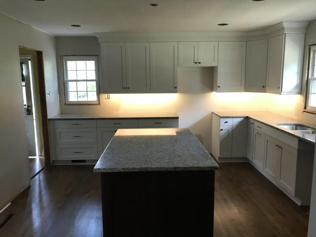 Richmond, VA - White shaker maple cabinets for the main kitchen and Espresso shaker for the island.  The White Tulum granite is the perfect color for the white and espresso cabinets.