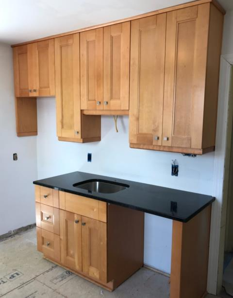 Henrico, VA - We love our all wood maple double shaker cabinets paired with black pearl granite!