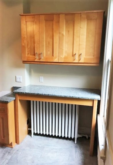 Richmond, VA - Just installed this space saving light maple bar with granite over a radiator in a cute fan apartment.