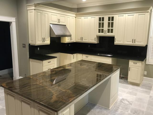 Richmond, VA - Just finished installing this beautiful kitchen with our vanilla white cabinets, in-stock black pearl granite and a special order Raggio Di Luna granite for the large island. We can't wait to see it after the appliances and light fixtures go in!