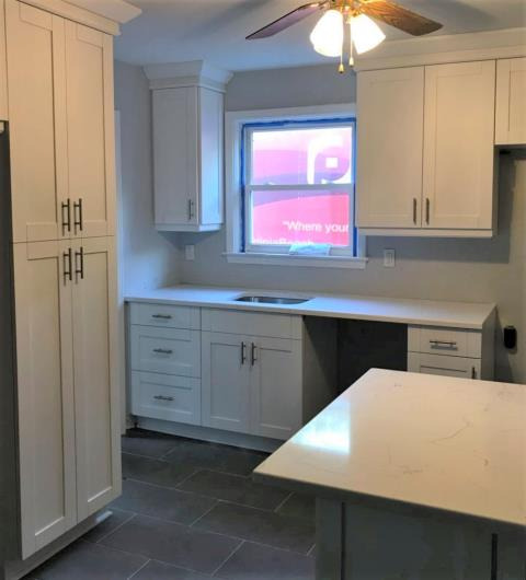 Richmond, VA - Our in-stock all wood white shaker cabinets and classical white quartz have completely transformed this cozy kitchen.