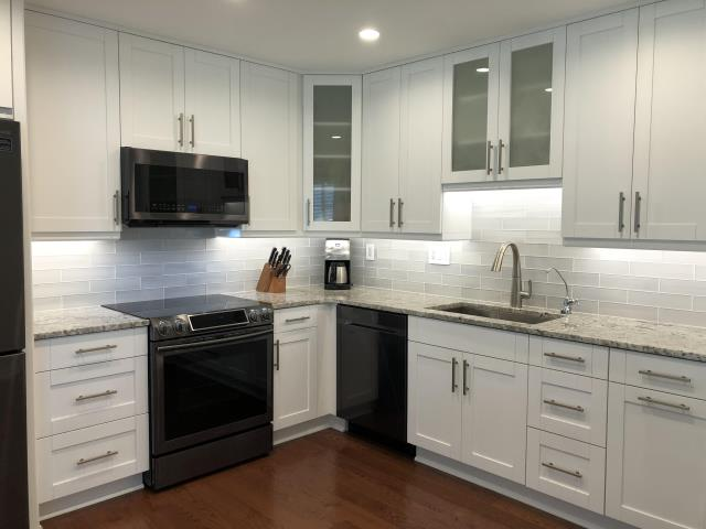 Richmond, VA - We love this kitchen!! Our white shaker cabinets and white ice granite look bright and fresh with our customers new sleek tile and warm wood floor.