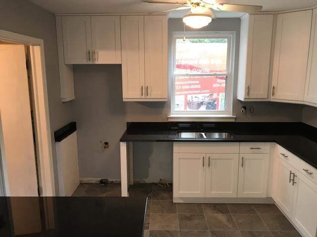 Richmond, VA - The new buyer will love this timeless kitchen with our in-stock white shaker cabinets and Black Pearl granite counters.