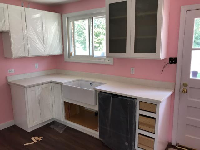 Richmond, VA - Our Lalico White quartz countertop looks great with client's farm sink.