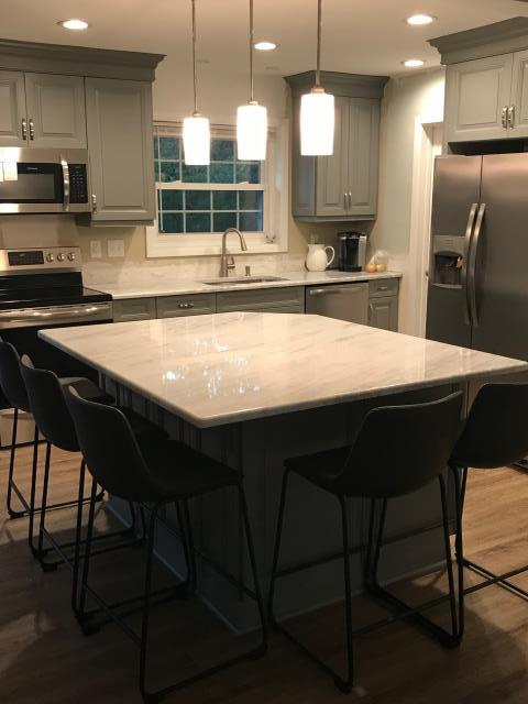Williamsburg, VA - What a gorgeous kitchen!!!  Our in-stock gray raised panel cabinets look spectacular with the Shadow Storm counter.