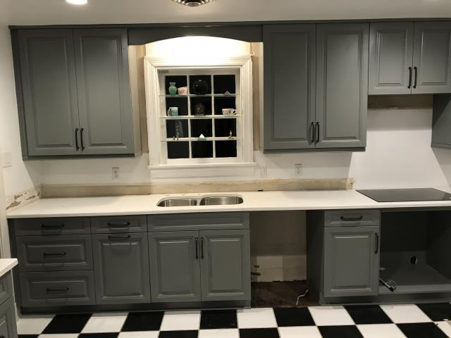 Richmond, VA - We completed this kitchen, cabinets and counters, all in one day.  The cabinet style is our in-stock gray cabinets with the Classical White Quartz.  Now we just need the appliances and the tile splash.