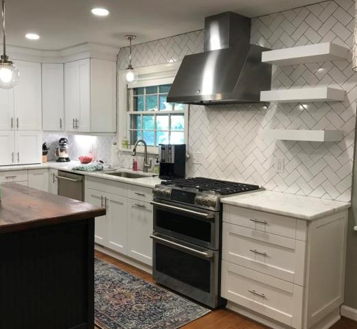 Richmond, VA - Kitchen and Bath had the pleasure of installing a kitchen for this client's mother and sister a couple years ago.  We now just completed her kitchen with our in-stock white shaker cabinets and the Shadow Storm.  Our floating shelves complement nicely with the herringbone tile splash.