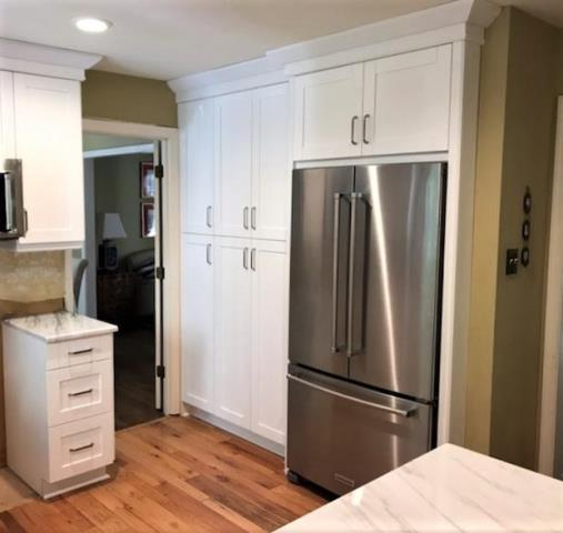 Richmond, VA - It's amazing how much larger a kitchen feels when you remove the old built in pantry and add new pantry cabinets to match your new kitchen cabinets. We love providing bonus functional storage for our clients.  Our white shaker cabinets pair perfectly with our Shadow Storm.