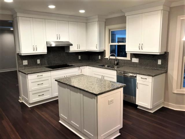 Rockville, VA - Just finished installing this beautiful white shaker kitchen with new caledonia granite. We love the way our cabinets, counters and backsplash stand out against the homeowners new flooring and wall color!