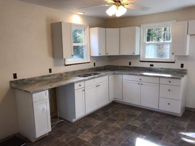 Mechanicsville, VA - Fantasy Brown, one of my favorite counter options, with my client's white cabinets.