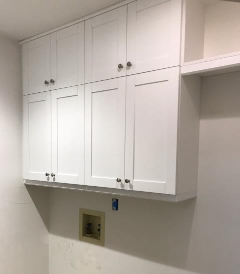 Richmond, VA - We just finished installing these crisp and clean white shaker cabinets for a laundry room.