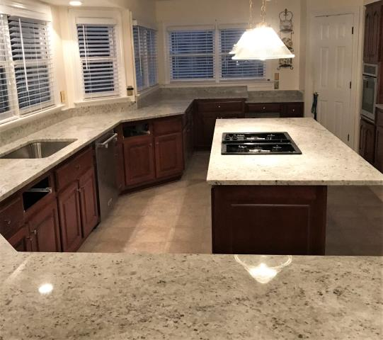 Midlothian, VA - My client selected the beautiful Colonial White granite for their huge kitchen and the bar counter.  We also installed two vanities with the Shadow Storm Marble.