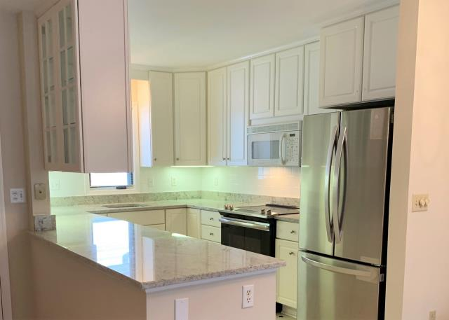 Richmond, VA - Just installed a beautiful Colonial White granite for a return client. It's the perfect pair for the existing white tile splash and white cabinets.